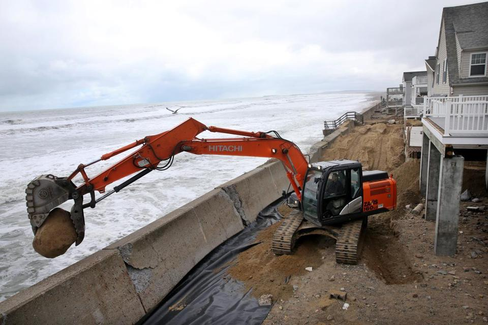 Crews worked on emergency repairs along the sea wall on Ocean Road North in Duxbury.